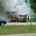 Ann Arbor, Mich.– June 11: A lone, unidentified volunteer firefighter battles a wicked car fire on eastbound M-14 while waiting for fire trucks to arrive. This brave firefighter, who arrived first on the scene in a...